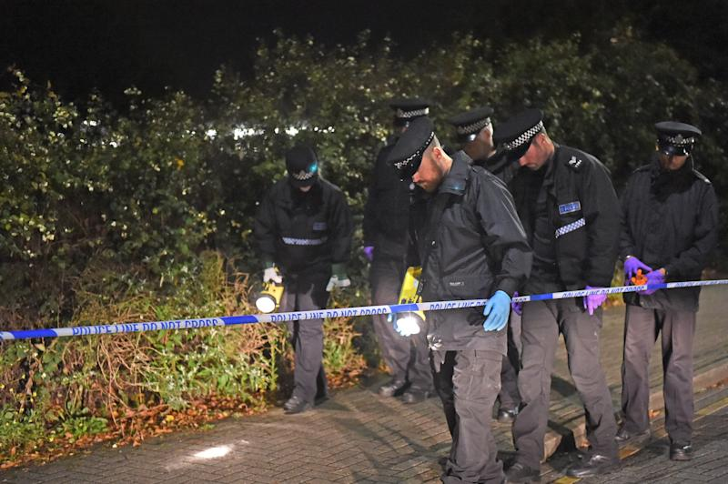Police searching outside Hillingdon underground station in London, where a murder investigation has been launched after a man was stabbed to death.
