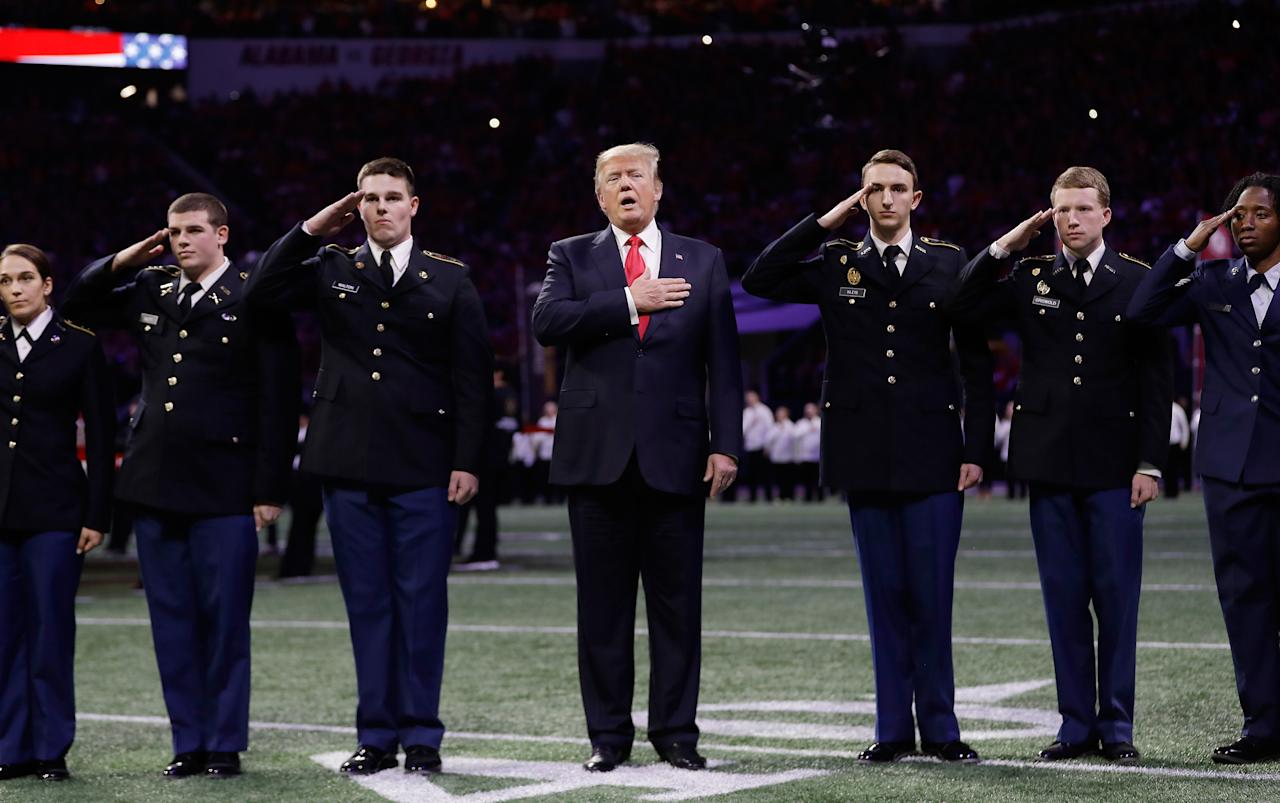 <p>President Donald Trump sings the national anthem before the NCAA college football playoff championship game between Georgia and the AlabamaMonday, Jan. 8, 2018, in Atlanta. (AP Photo/David J. Phillip) </p>