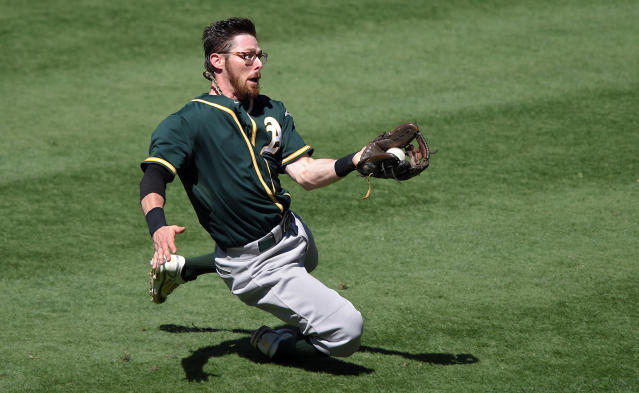 Oakland Athletics second baseman Eric Sogard makes a catch on a ball hit by Los Angeles Angels' Gordon Beckham during the sixth inning of a baseball game, Sunday, Aug. 31, 2014, in Anaheim, Calif. (AP Photo/Mark J. Terrill)