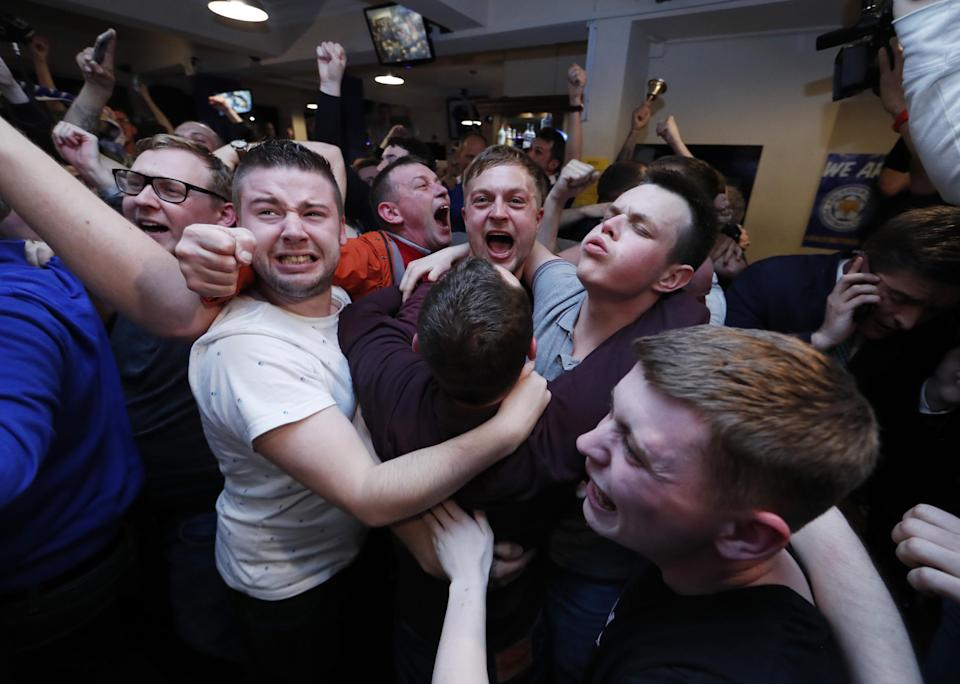 Britain Football Soccer - Leicester City fans watch the Chelsea v Tottenham Hotspur game in pub in Leicester - 2/5/16 Leicester City fans celebrate winning the Premier League Reuters / Eddie Keogh Livepic