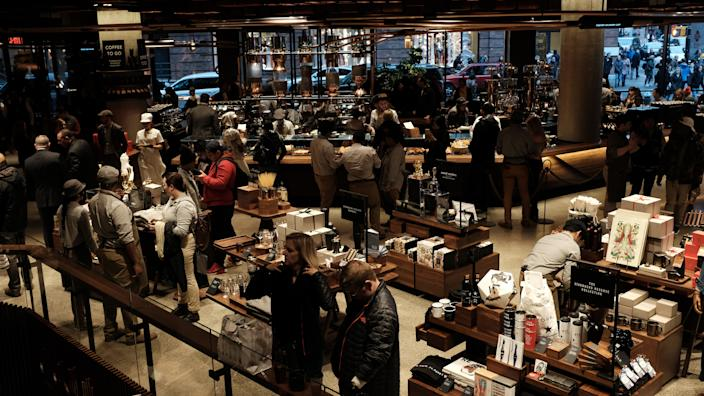 NEW YORK, NEW YORK - DECEMBER 14: People gather at a newly opened Starbucks' Reserve Roasteries in the Meatpacking District on on December 14, 2018 in New York City. The 20,000 square feet coffee store features three floors of coffee and cocktail bars, gourmet food, coffee beans and coffee brewing accessories. This is Starbuck's second Reserve Roasteries in the United States after a Seattle location. (Photo by Spencer Platt/Getty Images)