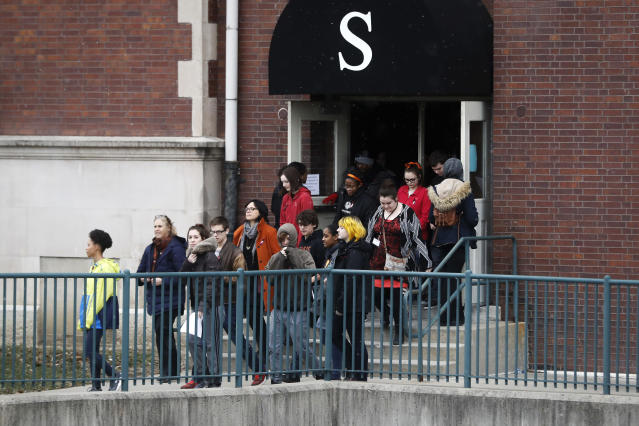 <p>Students exit the building before gathering on their soccer field during a 17-minute walkout protest at the Stivers School for the Arts, Wednesday, March 14, 2018, in Dayton, Ohio. Students across the country planned to participate in walkouts Wednesday to protest gun violence, one month after the deadly shooting inside a high school in Parkland, Fla. (Photo: John Minchillo/AP) </p>