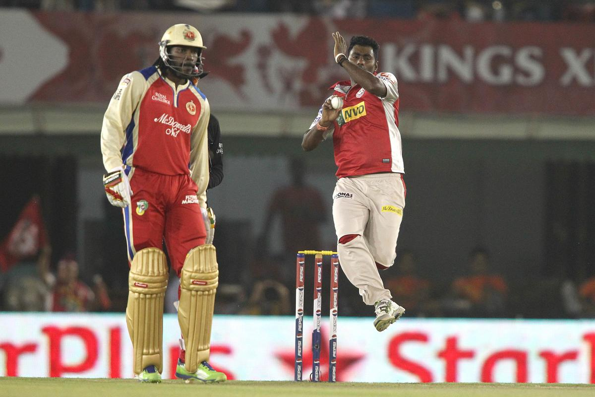 Parvinder Awana of Kings XI Punjab sends down a delivery as Chris Gayle of the Royal Challengers Bangalore backs up during match 51 of the Pepsi Indian Premier League (IPL) 2013 between Kings XI Punjab and the Royal Challengers Bangalore held at the PCA International Stadium in Mohali on the 6th May 2013..Photo by Shaun Roy-IPL-SPORTZPICS ..Use of this image is subject to the terms and conditions as outlined by the BCCI. These terms can be found by following this link:..https://ec.yimg.com/ec?url=http%3a%2f%2fwww.sportzpics.co.za%2fimage%2fI0000SoRagM2cIEc&t=1498443093&sig=nP0Dl3I.p89ZN8kM8jg1tg--~C