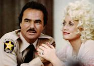 <p>Switching up his go-to genre, Reynolds showcased his singing skills alongside Dolly Parton in the 1981 musical. (Photo: Universal Pictures/courtesy Everett Collection) </p>
