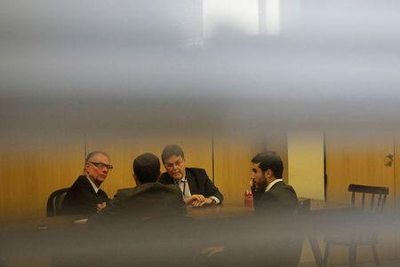 Brazilian Olympic Committee (COB) President Carlos Arthur Nuzman (L) talks with his lawyers before his hearing at the Federal Police headquarters in Rio de Janeiro, Brazil, September 5, 2017. REUTERS/Ricardo Moraes