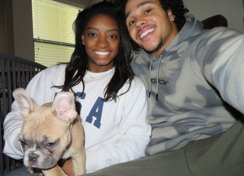 """<p>In February, the couple debuted their dog, Lilo. Both humans look ecstatic; their French bulldog, not so much. (Photo: <a rel=""""nofollow noopener"""" href=""""https://www.instagram.com/p/BfEgfkwHyd4/?hl=en&taken-by=simonebiles"""" target=""""_blank"""" data-ylk=""""slk:Simone Biles via Instagram"""" class=""""link rapid-noclick-resp"""">Simone Biles via Instagram</a>) </p>"""