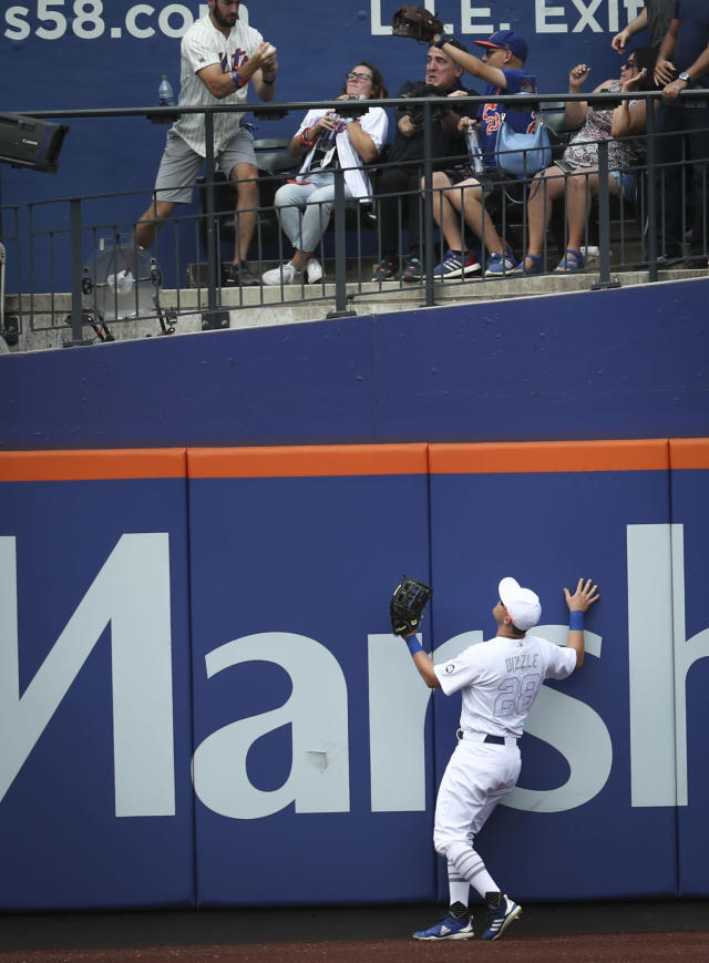 New York Mets' J.D. Davis watches as a fan catches a home run during the second inning of a baseball game against the Atlanta Braves, Sunday, Aug. 25, 2019, in New York. (AP Photo/Bebeto Matthews)