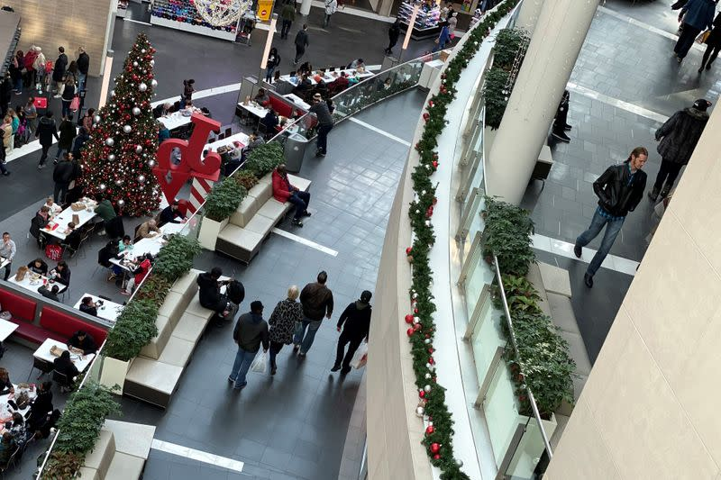 Shoppers make their way through Fashion Centre at Pentagon City, decorated for the holidays, in Arlington, Virginia