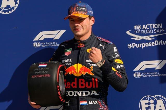 Max Verstappen celebrates after claiming pole position at the Dutch Grand Prix