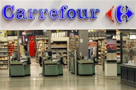 The logo of Carrefour is seen at the entrance of the Carrefour's Bercy hypermarket in Charenton Le Pont, near Paris