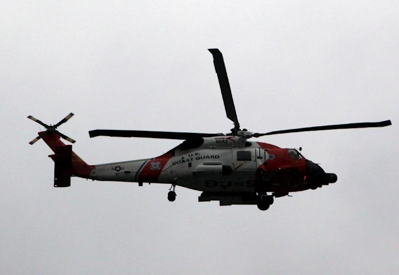 The US Coast Guard was alerted of a reported collision between two Marine Corps helicopters carrying six crew members each
