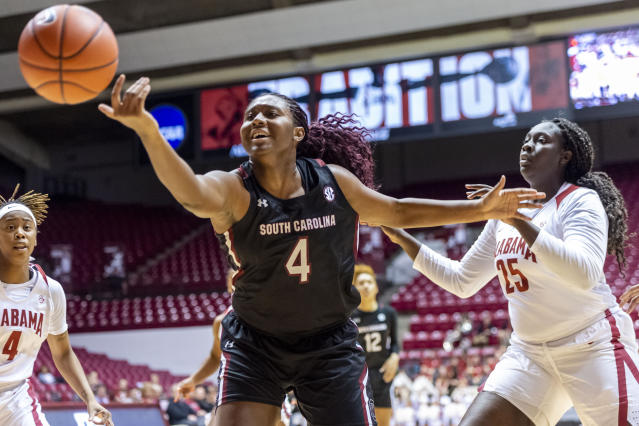 South Carolina forward Aliyah Boston (4) chases a rebound with Alabama forward Ashley Knight (25) pursuing during the first half of an NCAA college basketball game, Sunday, Jan. 5, 2020, in Tuscaloosa, Ala. (AP Photo/Vasha Hunt)