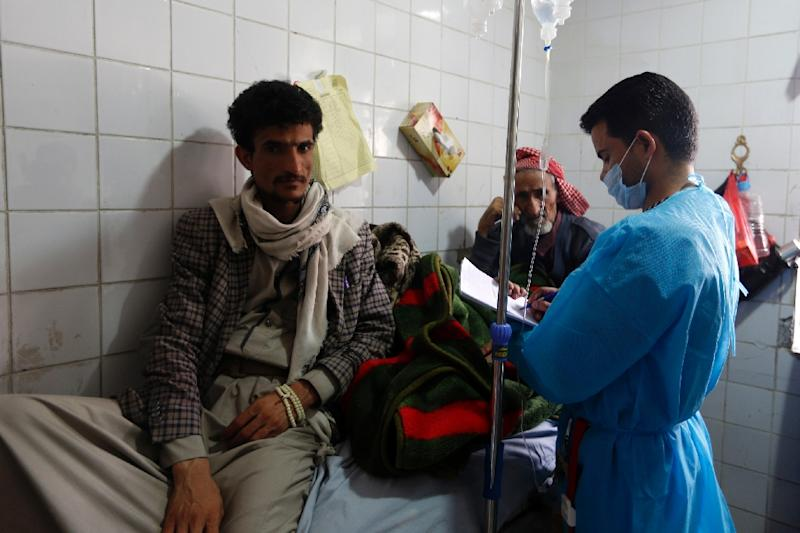 Yemeni men suspected of being infected with cholera receive treatment at a hospital in Sanaa (AFP Photo/Mohammed HUWAIS)