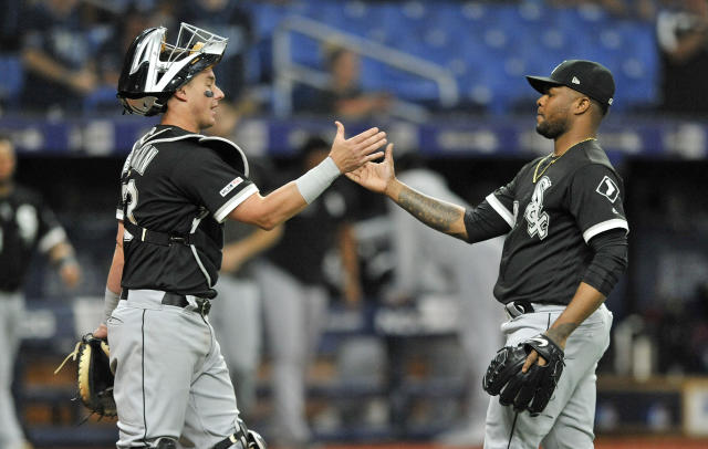 Chicago White Sox catcher James McCann, left, and closer Alex Colome celebrate a 2-1 win over the Tampa Bay Rays during the 11th inning of a baseball game Saturday, July 20, 2019, in St. Petersburg, Fla. (AP Photo/Steve Nesius)