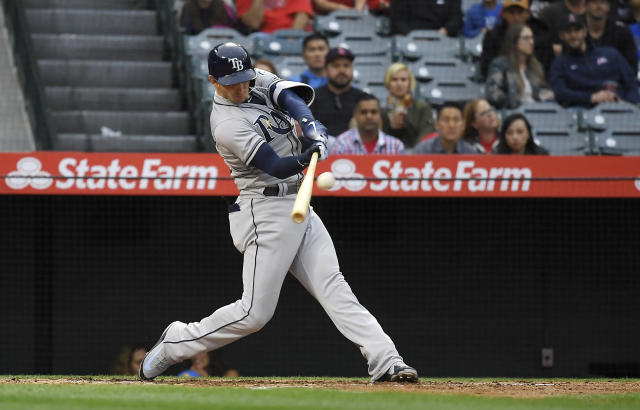 Tampa Bay Rays' Daniel Robertson hits a grand slam during the second inning of a baseball game against the Los Angeles Angels Saturday, May 19, 2018, in Anaheim, Calif. (AP Photo/Mark J. Terrill)