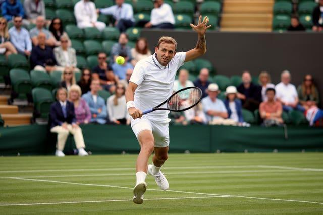Dan Evans plays a backhand volley during his victory over Feliciano Lopez