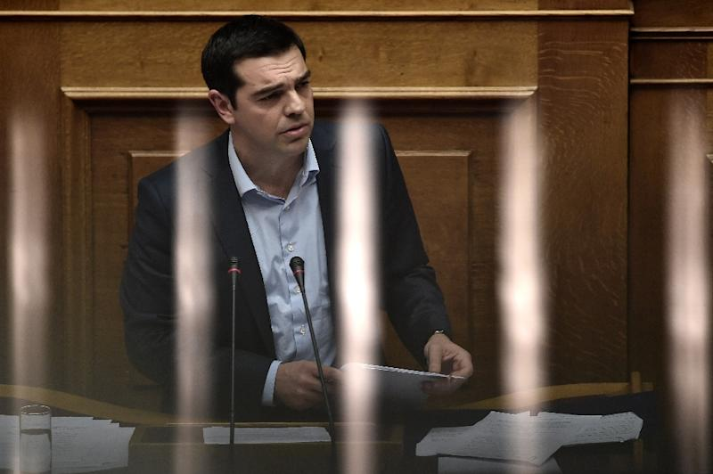 Greek Prime Minister Alexis Tsipras addresses a parliamentary session in Athens on March 30, 2015 (AFP Photo/Aris Messinis)