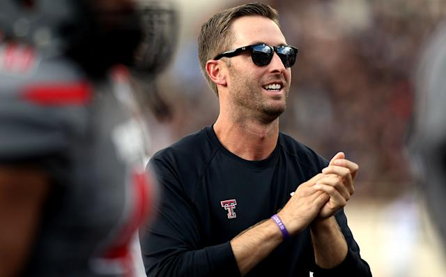 Texas Tech's Kliff Kingsbury watches his team warm up before their NCAA college football game against TCU in Lubbock, Texas, Thursday, Sept. 12, 2013