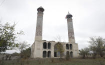 The Mosque is seen in Aghdam, after the Azerbaijani forces handed control that had been occupied by Armenian forces for a quarter-century, Aghdam, Azerbaijan, Friday, Nov. 20, 2020. Units of the Azerbaijani army on Friday morning entered the Aghdam region, a territory ceded by Armenian forces in a cease-fire agreement that ended six weeks of heavy fighting. (AP Photo/Sergei Grits)