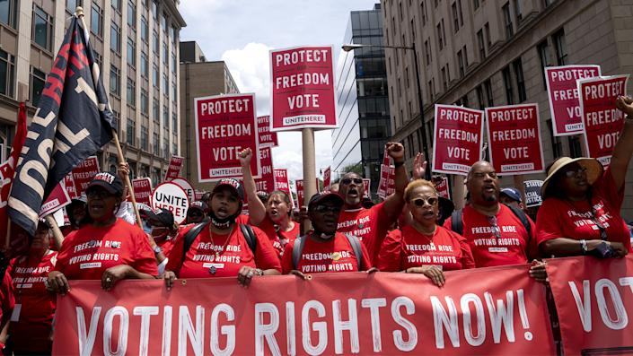 Demonstrators march during a Freedom Ride for Voting Rights rally in Washington, D.C., U.S., on Saturday, June 26, 2021. (Stefani Reynolds/Bloomberg via Getty Images)