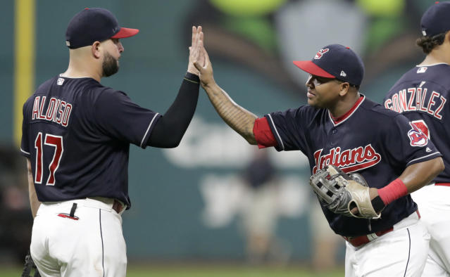 Cleveland Indians' Yonder Alonso, left, celebrates with Cleveland Indians' Jose Ramirez after the Indians defeated the Minnesota Twins 8-1 in a baseball game, Tuesday, Aug. 28, 2018, in Cleveland. (AP Photo/Tony Dejak)