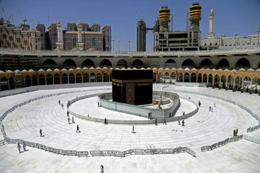 A greatly limited number of Muslim worshippers walk around the sacred Kaaba in Mecca's Grand Mosque, Islam's holiest site, during the coronavirus pandemic