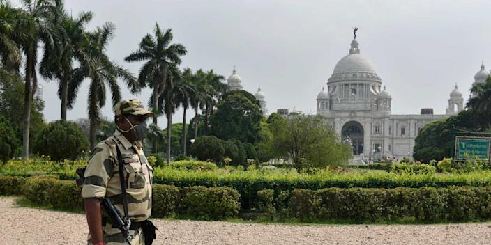 A security personnel keeps watch at Victoria Memorial Hall during the second day of lockdown imposed by the state government to curb the spread of coronavirus on March 24, 2020 in Kolkata, India.