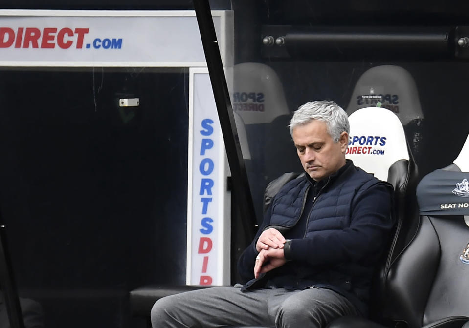 Tottenham's manager Jose Mourinho check his watch during the English Premier League soccer match between Newcastle United and Tottenham Hotspur at St. James' Park in Newcastle, England, Sunday, April 4, 2021. (Peter Powell/Pool via AP)