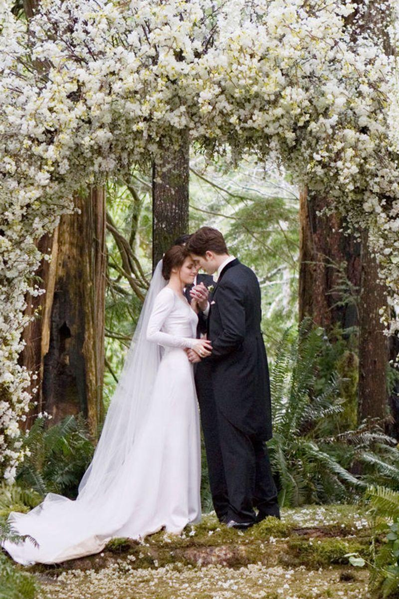 <p>In a fairy-tale-like wedding ceremony, Bella and Edward were married in the forest in a scene that upset only Team Jacob. Kristen Stewart wore a stunningly simple, long-sleeve dress with an elaborate lace back.<br></p>