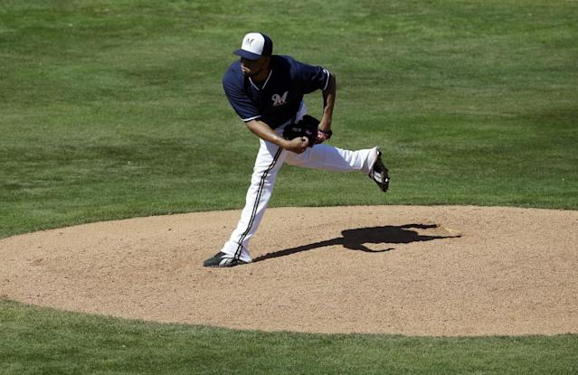 Milwaukee Brewers' Francisco Rodriguez throws during the fifth inning of an exhibition spring training baseball game against the Cincinnati Reds Saturday, March 15, 2014, in Phoenix. (AP Photo/Morry Gash)