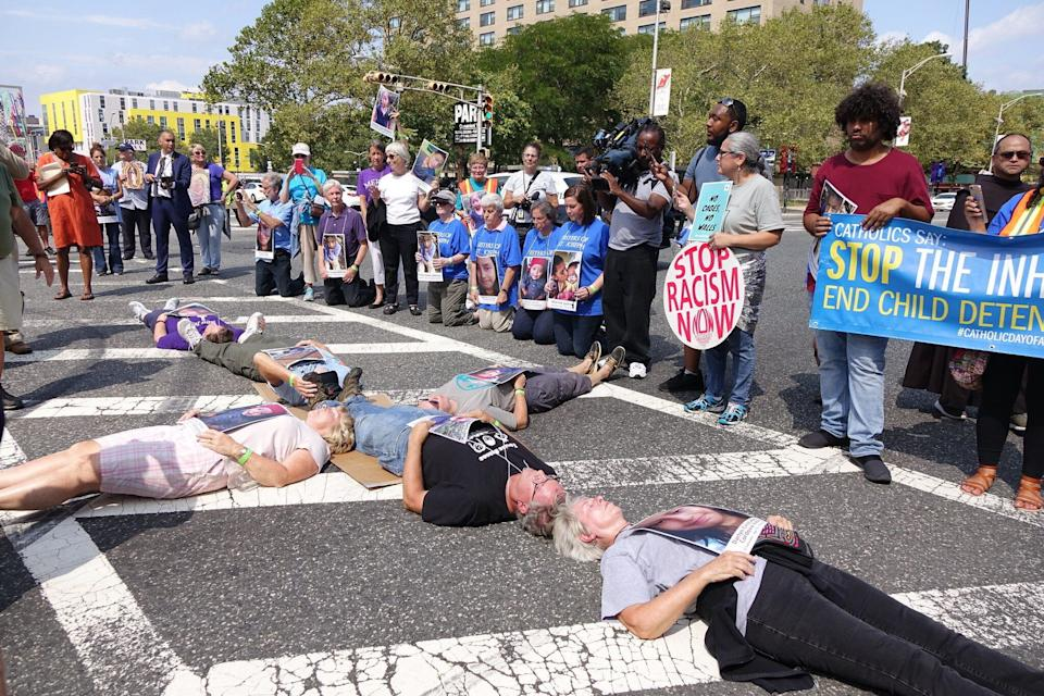Catholic protesters form the shape of the cross and block a road outside Newark's Peter Rodino Federal Building, hoping to raise awareness of ICE's detention policies. (Photo: Ignatian Solidarity Network)