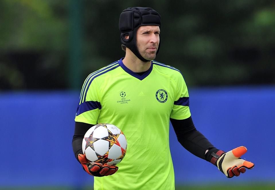 Chelsea's Czech goalkeeper Petr Cech attends training ahead of their UEFA Champions League, group G football match against Schalke 04 at Chelsea's training ground, Stoke D'Abernon, southwest of London on September 16, 2014. Chelsea play Schalke 04 on September 17, 2014. AFP PHOTO / GLYN KIRK        (Photo credit should read GLYN KIRK/AFP via Getty Images)