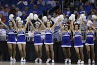 Saint Louis cheerleaders perform during the first half against North Carolina State in a second-round game in the NCAA college basketball tournament Thursday, March 20, 2014, in Orlando, Fla. (AP Photo/John Raoux)