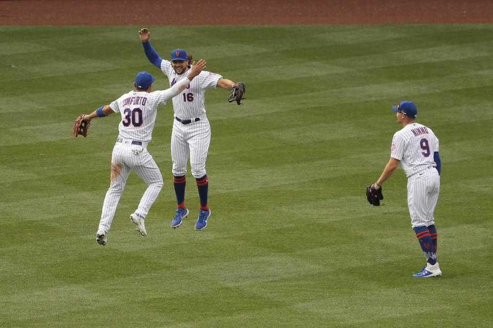 New York Mets outfielders Michael Conforto, left, Jake Marisnick, center, and Brandon Nimmo react after a baseball game against the Atlanta Braves at Citi Field, Friday, July 24, 2020, in New York. (AP Photo/Seth Wenig)