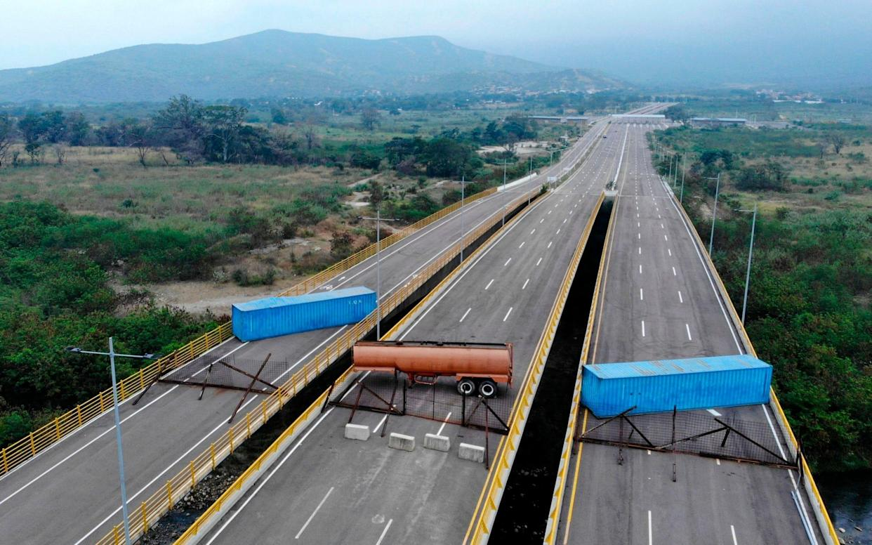 The Tienditas Bridge, on the border between Colombia Venezuela, after Venezuelan military forces blocked it with containers - AFP