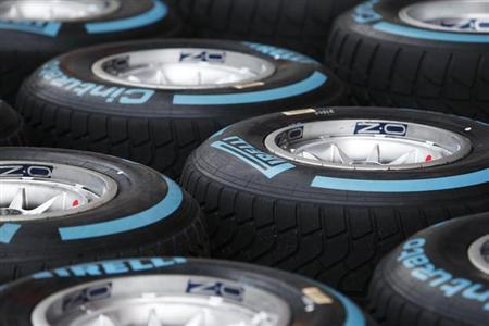 """Pirelli """"Full Wet"""" Formula One tyres are pictured in the pit ahead of the Singapore F1 Grand Prix September 18, 2013. REUTERS/Tim Chong"""