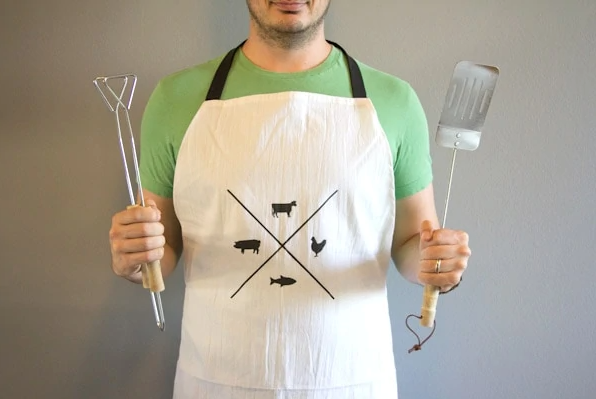 """<p>If Dad's the ultimate grillmaster, he'll appreciate this apron to help keep his favorite shirt safe. You'll need a flour sack towel, some fabric paint, and some basic sewing skills. </p><p><em>Get the tutorial at <a href=""""https://lovelyindeed.com/diy-fathers-day-gift-apron/"""" rel=""""nofollow noopener"""" target=""""_blank"""" data-ylk=""""slk:Lovely Indeed"""" class=""""link rapid-noclick-resp"""">Lovely Indeed</a>. </em></p>"""