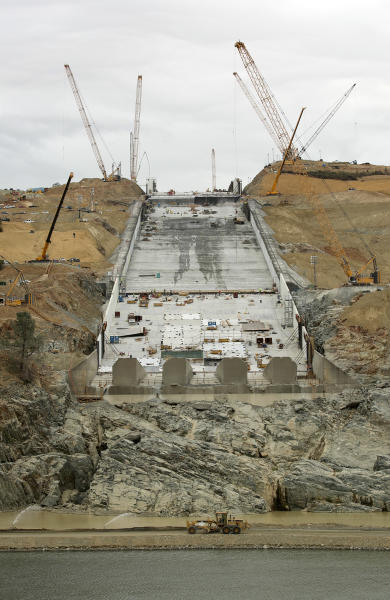 FILE - This Oct. 19, 2017 file photo shows repair work on the damaged main spillway of the Oroville Dam in Oroville, Calif. One year after the closest thing to disaster at a major U.S. dam in a generation, federal dam regulators say they are looking hard at how they overlooked the built-in weaknesses of old dams like California's Oroville Dam for decades, and expect dam managers around the country to study their old dams and organizations equally hard. (AP Photo/Rich Pedroncelli, file)