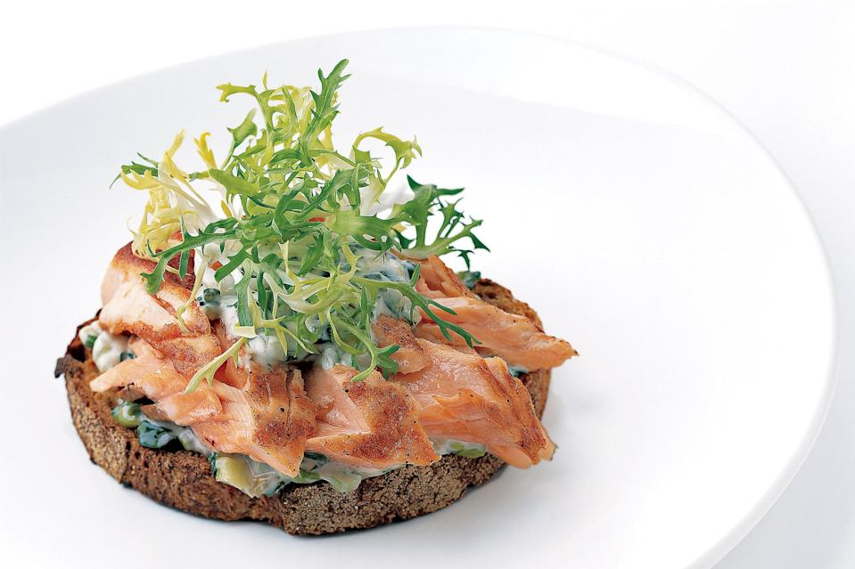 "Grilled bread—and grilling the salmon outdoors instead of in a grill pan—takes this open-face sandwich even further over the top. <a href=""https://www.epicurious.com/recipes/food/views/pan-grilled-salmon-on-toast-with-scallion-mayonnaise-108105?mbid=synd_yahoo_rss"" rel=""nofollow noopener"" target=""_blank"" data-ylk=""slk:See recipe."" class=""link rapid-noclick-resp"">See recipe.</a>"