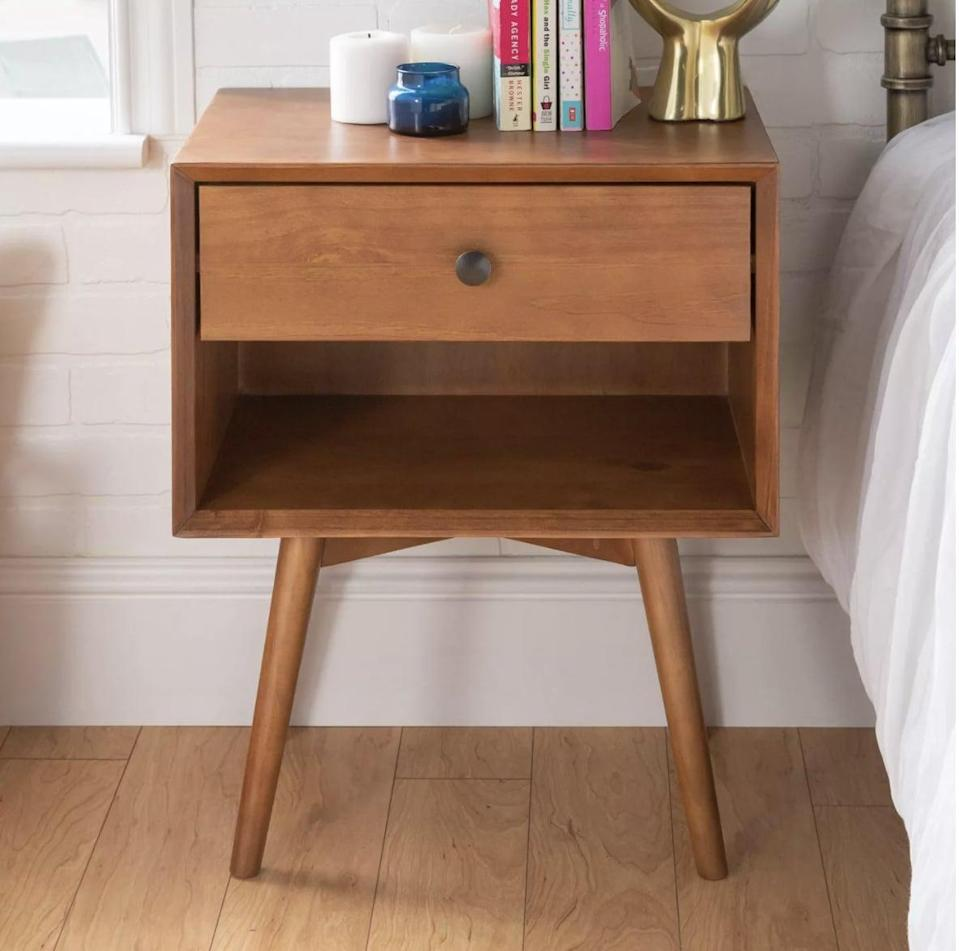 <p>Keep your favorite reads or magazines on this sleek <span>Saracina Home Greenberg Nightstand</span> ($127), which is made from responsibly sourced pined wood and can totally double as an end table.</p>