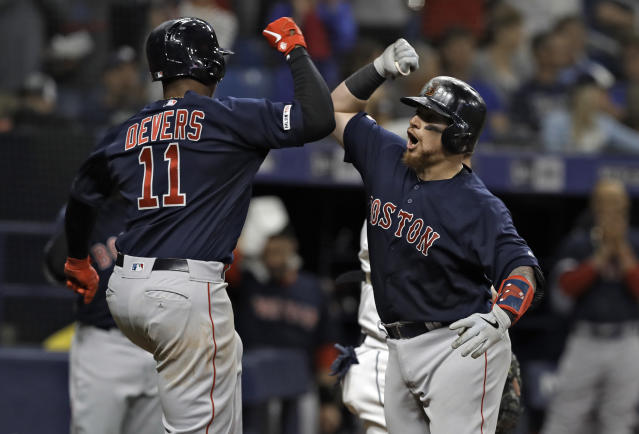 Boston Red Sox's Christian Vazquez, right, celebrates his two-run home run off Tampa Bay Rays relief pitcher Ryan Yarbrough with Rafael Devers during the fifth inning of a baseball game Friday, April 19, 2019, in St. Petersburg, Fla. (AP Photo/Chris O'Meara)