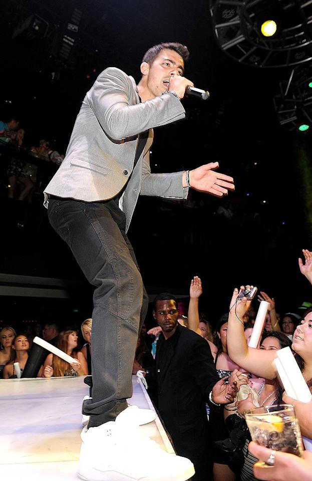 """Also in Sin City? Joe Jonas, who celebrated his 22nd birthday early -- it was actually Monday, August 15 -- by lounging at Aria's Liquid Pool, gambling at Deuce Lounge, and performing tunes from his new solo album, <i>FastLife</i>, at Haze nightclub on Saturday. <a href=""""http://www.eonline.com/news/hwood_party_girl/happy_birthday_joe_jonas_heres_how/258047"""">E! Online</a> reported the JoBro was surrounded by girls at his VIP table. <a href=""""http://www.wireimage.com"""" target=""""new"""">WireImage.com</a> - August 13, 2011"""