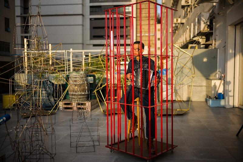 Local artists are concerned Beijing's growing influence is creating a climate of fear that is stifling creativity and threatens the nascent grassroots art scene Hong Kong says it wants to enrich (AFP Photo/Anthony WALLACE)