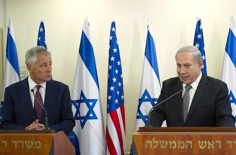 """U.S. Secretary of Defense Chuck Hagel, left, listens at a joint press conference with Israeli Prime Minister Benjamin Netanyahu at the latter's office in Jerusalem, on Tuesday, April 23, 2013. Hagel said the U.S. and Israel need to ensure that their alliance is """"closer than ever,"""" as Mideast security challenges grow more complicated. (AP Photo/Jim Watson, Pool)"""