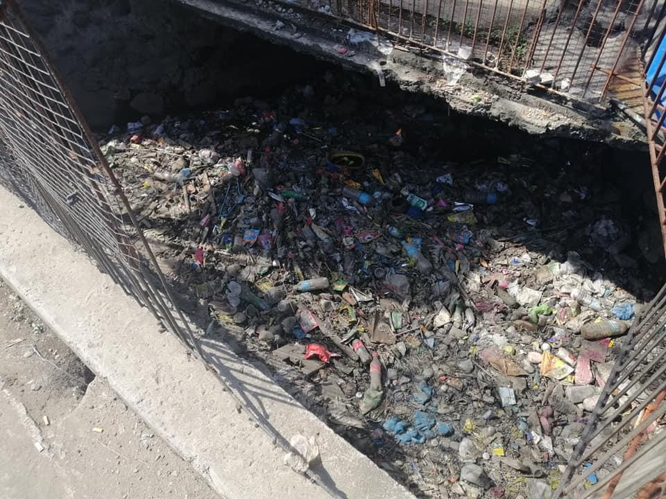 A Philippines canal filled with plastic garbage.