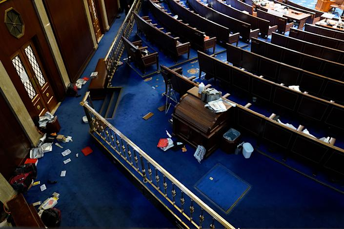 """Papers and other materials litter the House Chamber after it was evacuated.<span class=""""copyright"""">Andrew Harnik—AP</span>"""