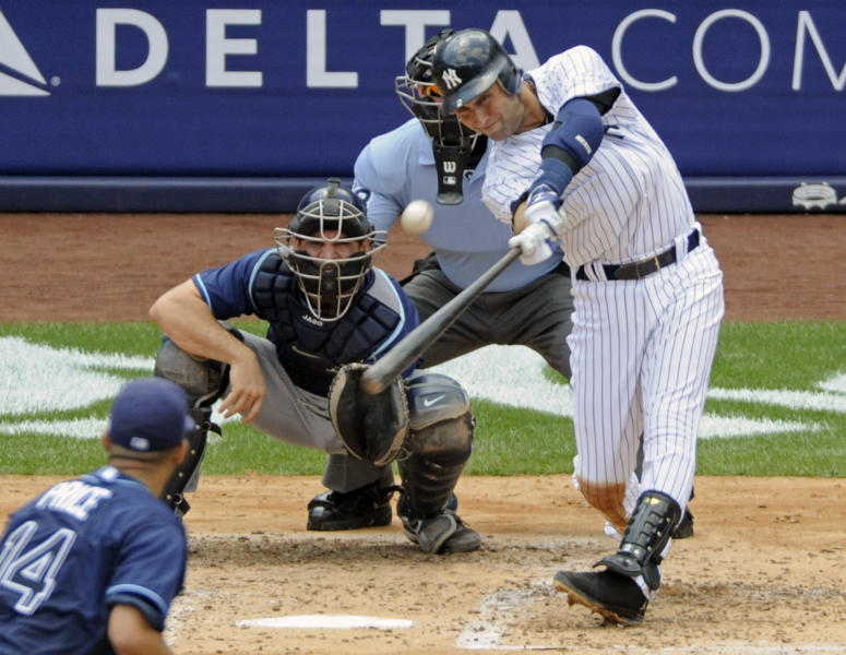 FILE - In this July 9, 2011, file photo, New York Yankees' Derek Jeter hits a home run for his 3,000th career hit during the third inning of a baseball game against the Tampa Bay Rays at Yankee Stadium in New York. Jeter could be a unanimous pick when Baseball Hall of Fame voting is announced Tuesday, Jan. 21, 2020. (AP Photo/Bill Kostroun, File)