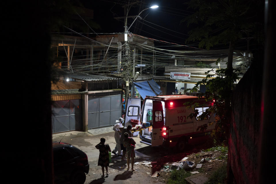 FILE - In this April 7, 2021, file photo, Mobile Emergency Care Service (SAMU) workers carry an elderly COVID-19 patient to an ambulance in Duque de Caxias, Rio de Janeiro state, Brazil. Nations around the world set new records Thursday, April 8, for COVID-19 deaths and new coronavirus infections, and the disease surged even in some countries that have kept the virus in check. Brazil became just the third country, after the U.S. and Peru, to report a 24-hour tally of COVID-19 deaths exceeding 4,000. (AP Photo/Felipe Dana, File)