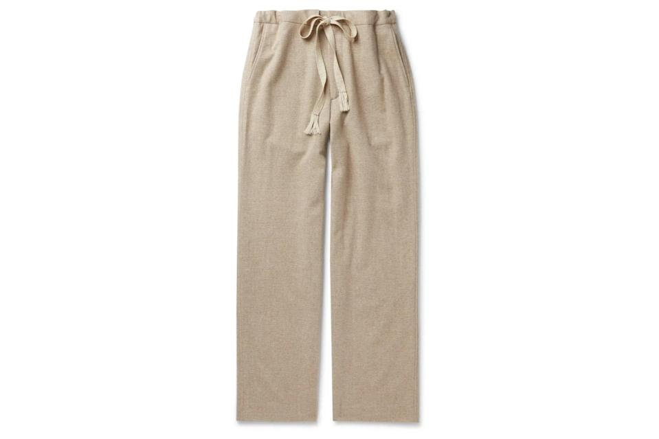 "$650, Mr Porter. <a href=""https://www.mrporter.com/en-us/mens/product/auralee/clothing/casual-trousers/wool-and-cashmere-blend-flannel-drawstring-trousers/30049528927132250"" rel=""nofollow noopener"" target=""_blank"" data-ylk=""slk:Get it now!"" class=""link rapid-noclick-resp"">Get it now!</a>"
