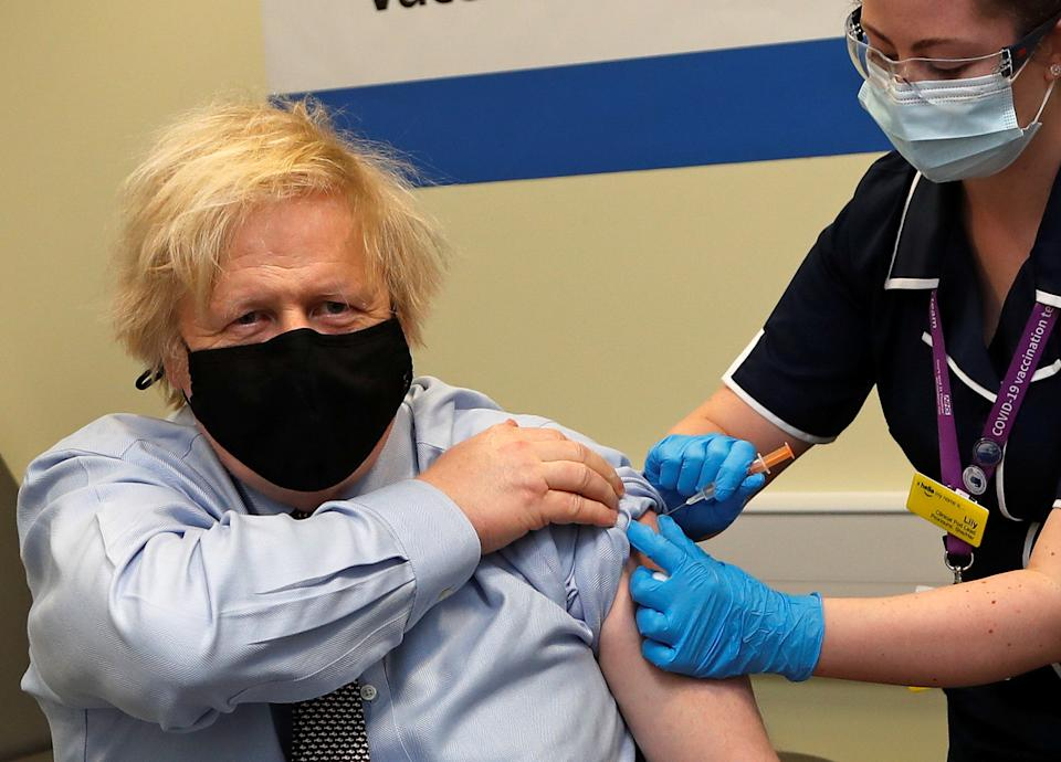 British Prime Minister Boris Johnson receives a dose of the Oxford/AstraZeneca COVID-19 vaccine, amid the coronavirus disease pandemic, in London, Britain March 19, 2021. Frank Augstein/Pool via REUTERS